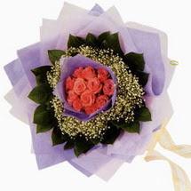 12 adet gül ve elyaflardan   Şanlıurfa çiçek yolla , çiçek gönder , çiçekçi