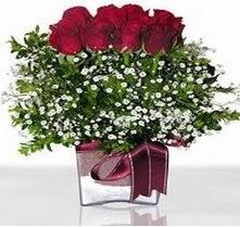 Şanlıurfa çiçek gönderme sitemiz güvenlidir  mika yada cam vazo içerisinde 7 adet gül